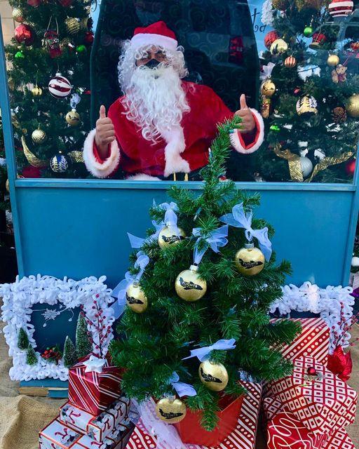 Santa behind plexiglass at Winter Wonderland market