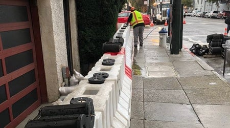 Temporary Flood Barriers Installed At Mission Intersection