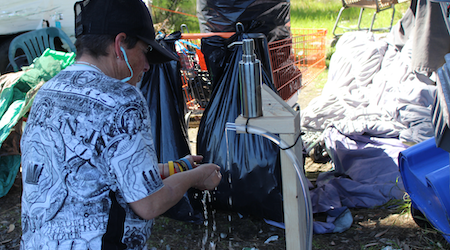 Oakland activists build hand-washing stations for unhoused, as city's sanitation plan falls short